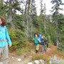 Explorations Academy Photo - Here are some of our students feeling triumphant on a multi-day backpacking trip, enjoying the beauty and bounty of our region. Explorations students develop a sense of leadership, environmental stewardship, and social responsibility both in the classroom and on the field.