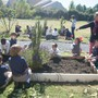 Christ Covenant School Photo #2 - Students spend time in the school garden planting, cultivating and harvesting fruits, vegetables and flowers.
