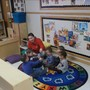 Canton KinderCare Photo - Miss Kim our lead Toddler teacher is doing her circle time activities with the children.