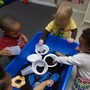 Fordson Road KinderCare Photo - Toddler Science - having fun exploring dirt at the sensory table.