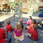 Old Sauk Road KinderCare Photo - Our guest of honor on military appreciation day reading the Preschool class a story