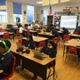 Saint Anne School Photo #1 - Class engaged in blended learning. Half of the class in direct instruction with the teacher, half engaged in personal digital learning on individual learning profiles on chromebooks.