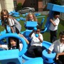 St Brigid School Photo - Ist grade students enjoying the play system in our school yard.