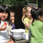 The Eastside Montessori School Photo #2 - Enjoying snack outdoors with friends.