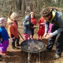 The Garden School of Marietta Photo - Tending the fire on a chilly day in the forest kindergarten.