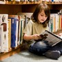 Walden School Photo #5 - A Walden student enjoys a book from the library.