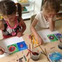 Montessori School At Lone Tree Photo - Kindergarten children learn about artists. In this photo, they are painting in a style similar to Wassily Kandinsky.