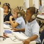 Abundant Life Christian Academy Photo #2 - Kindergarten students practicing typing skills in computer class.