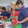 Naples Christian Academy Photo #4 - Students, parents, faculty and staff packed 154 shoeboxes for Operation Christmas Child! After packing, everyone enjoyed cake to celebrate Jesus and His coming.